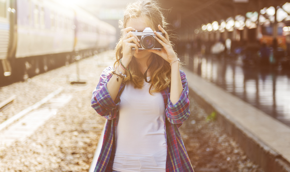 Girl Adventure Hangout Traveling Holiday Photography Concept via Shutterstock